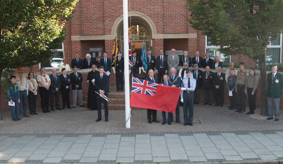 Dignitaries get ready to fly the navy ensign flag ahead of Merchant Navy Day