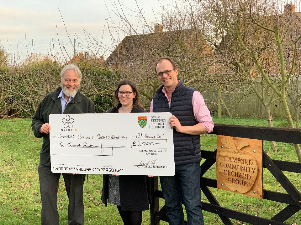 Dr Chris Hulbert from Stamford Community Orchard Group receives grant funding from Claire Saunders, InvestSK and Councillor Matthew Lee, South Kesteven District Council.